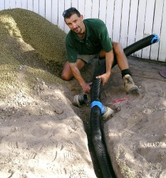 Brisbane landscapers 'Green Survival' did all the hard work, here laying ag pipe.