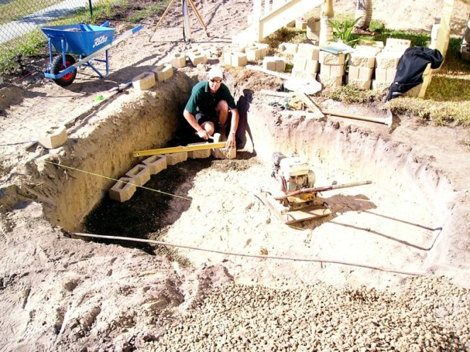 The ag pipe connects to a soakaway pit at the front of the house. Runoff collects here and soaks into the ground. It also acts as a sediment trap