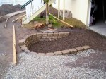 The soakaway, block retaining wall and gravel lining.