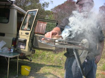 Throw another prawn on the Foxtel. Sizzling Solar Systems: Stan Cajdler demonstrates the art of solar cooking