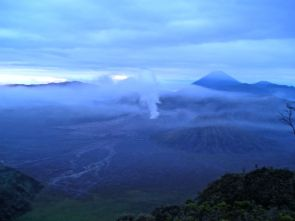 Dawn gradually reveals three volcanoes: Gunung Batok (nearest, extinct), Gunung Bromo (centre, active), Gunung Semeru (to rear, active)