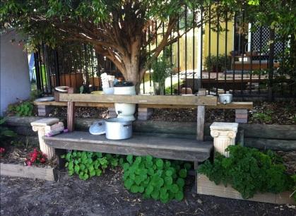 Kids' neighbourhood kitchen verge garden with seat for supervision